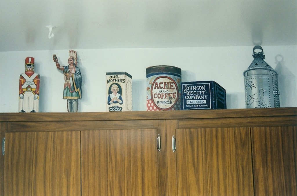 Faux country curios on top of cabinets. Kitchen. Roslyn, NY